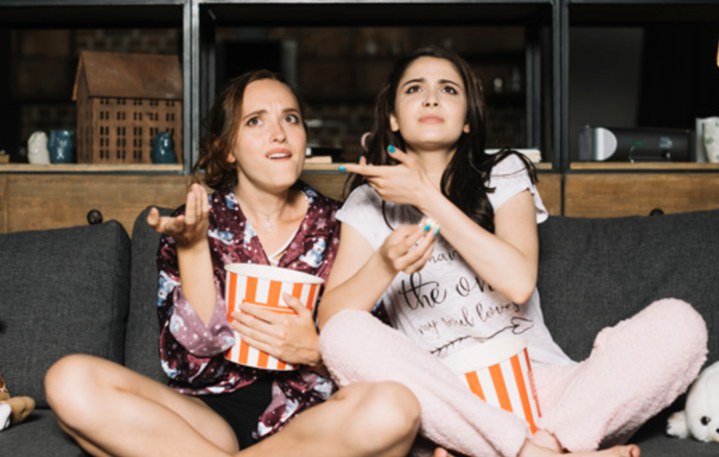 Girl friends watching a movie together
